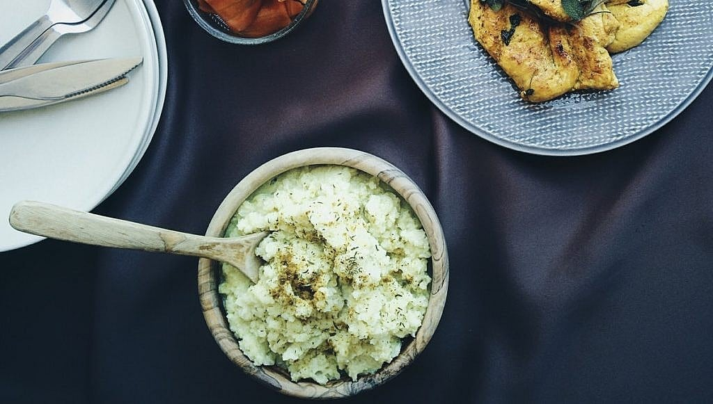 bowl of mashed cauliflower on a table
